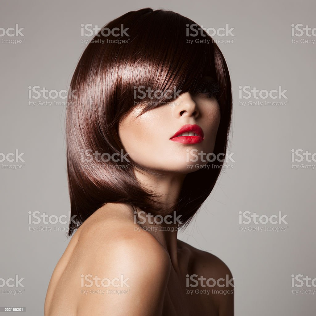 Beauty model with perfect long glossy brown hair. stock photo