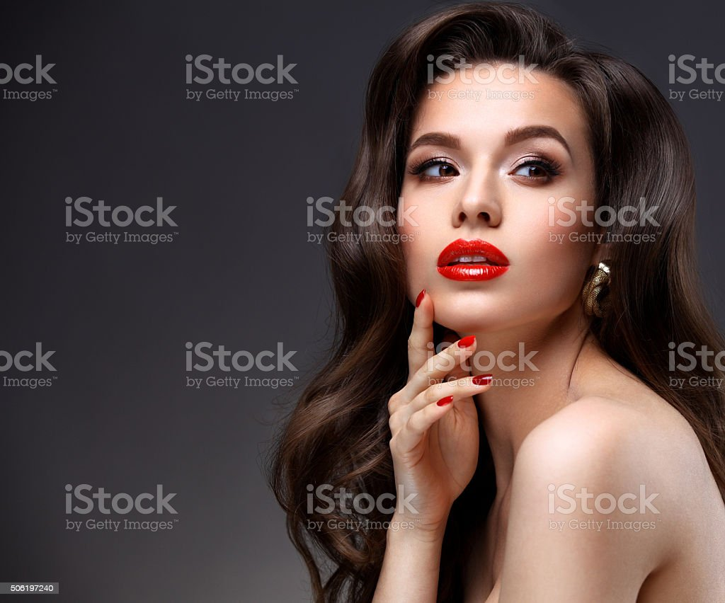 Beauty Model Woman with Long Brown Wavy Hair.  Red Lips stock photo