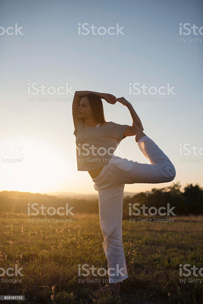 Beauty of yoga movement stock photo