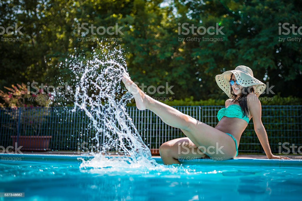 Beauty on the pool side stock photo
