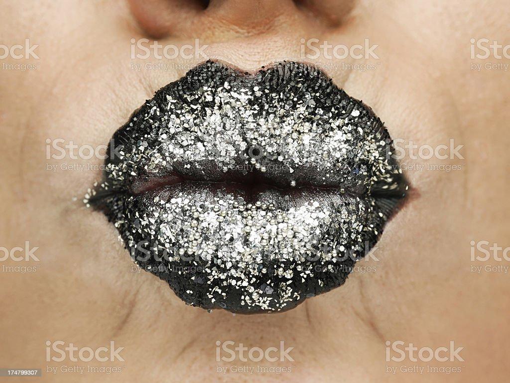 Beauty photograph (close-up) of black shiny female lips. stock photo