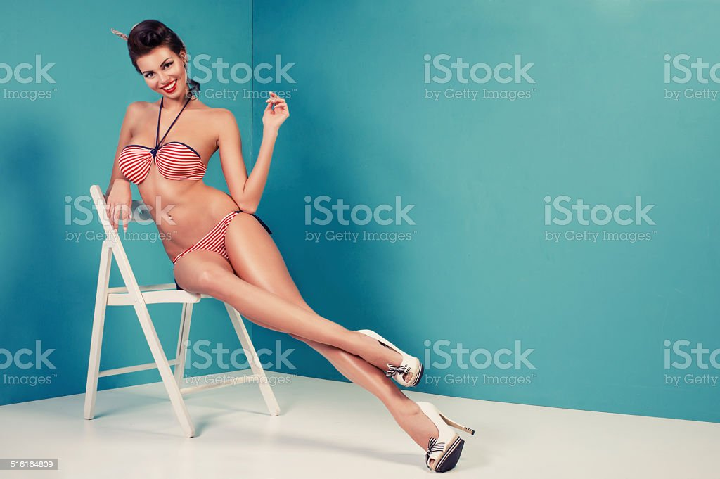 Beauty pinup girl in a sailor swimsuit stock photo