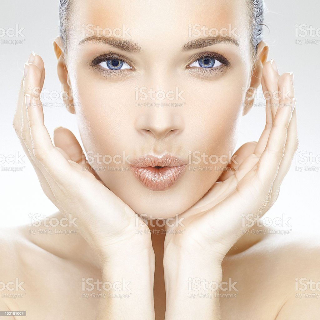 Beauty portrait of a beautiful young woman blowing kisses royalty-free stock photo