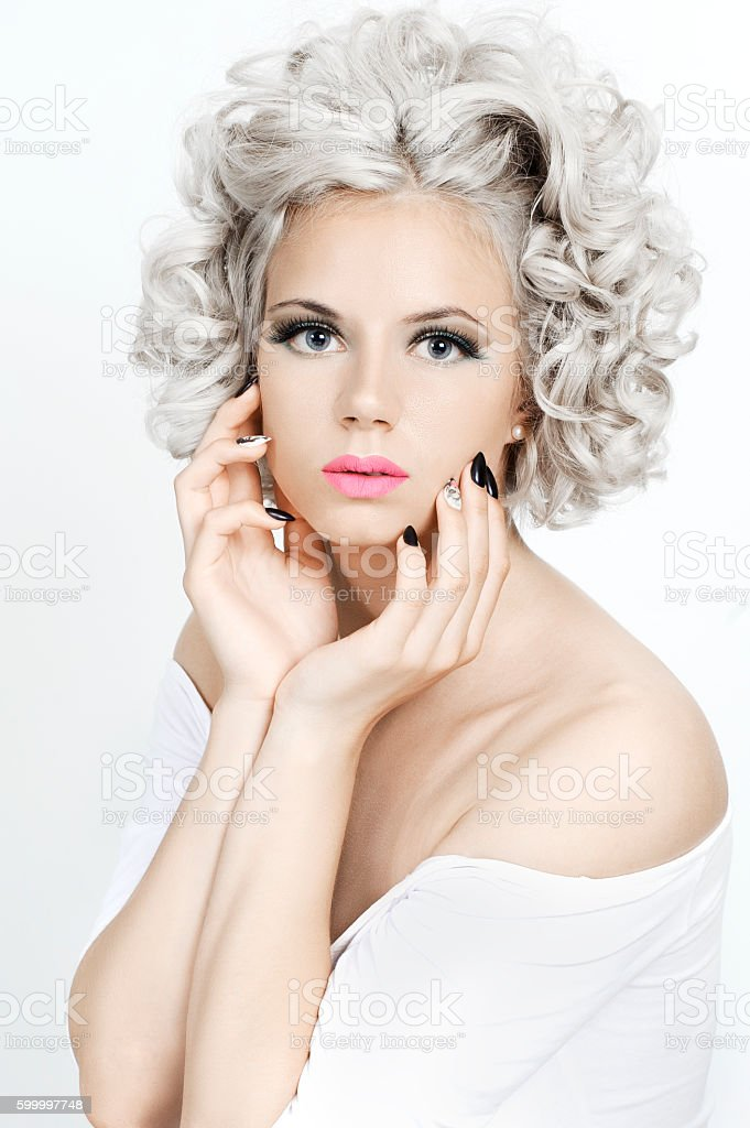Beauty portrait of a girl with curly silver hair. stock photo
