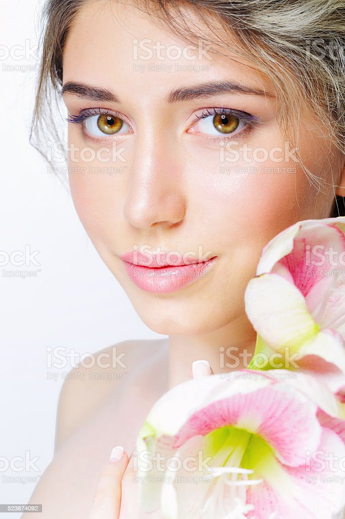 Beauty portrait of a woman with flower stock photo