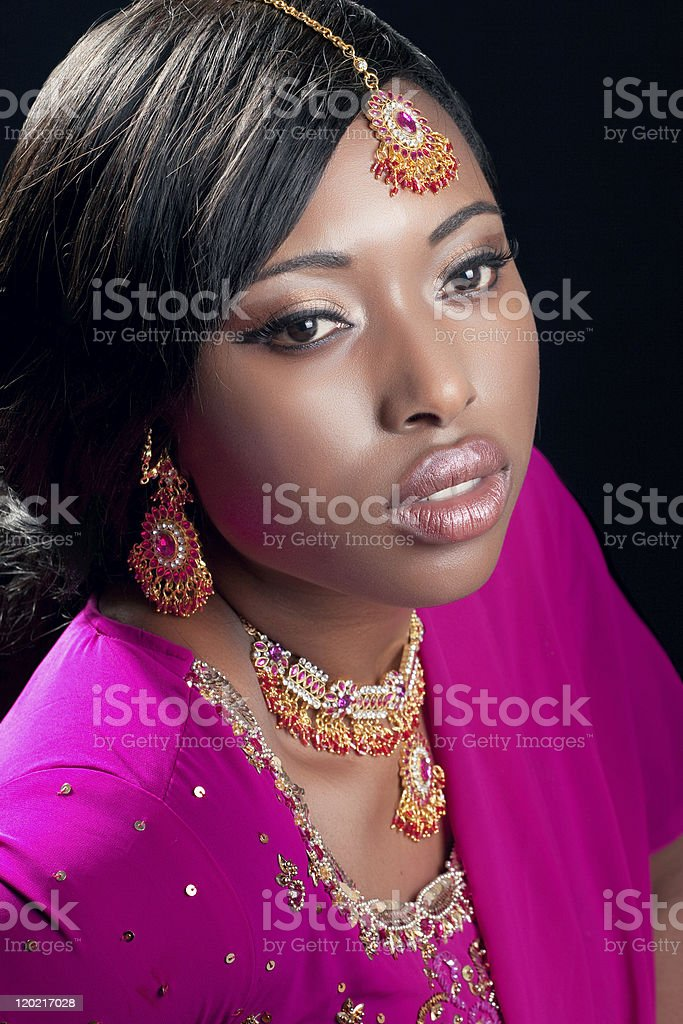 Beauty portrait of a young woman wearing indian clothes royalty-free stock photo