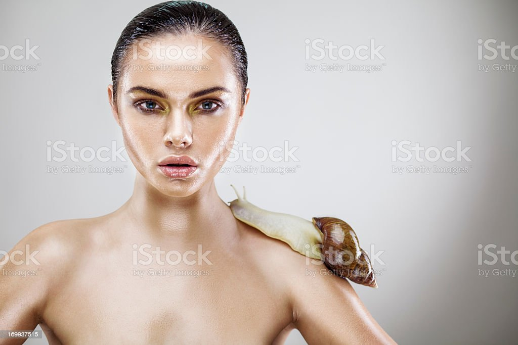 Beauty portrait of a young woman with snail royalty-free stock photo