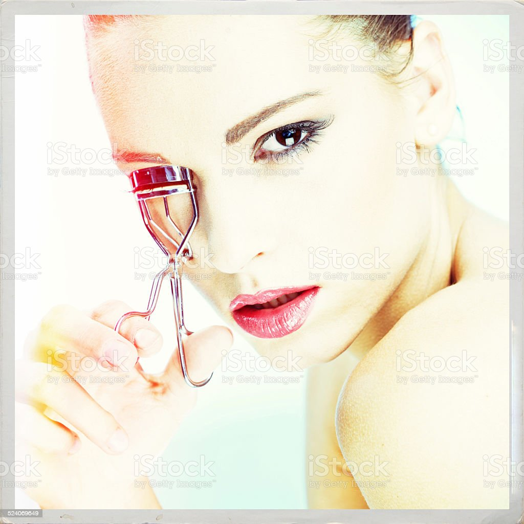 beauty portrait of girl with Eyelash Curler stock photo