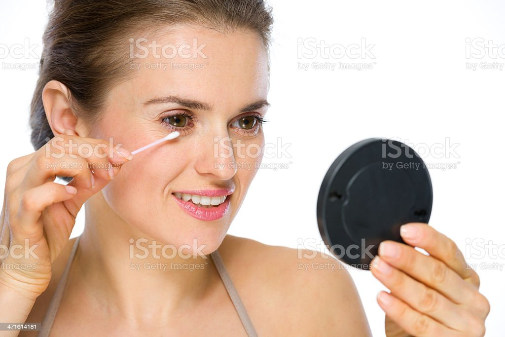 Beauty portrait of happy young woman using cotton swabs royalty-free stock photo