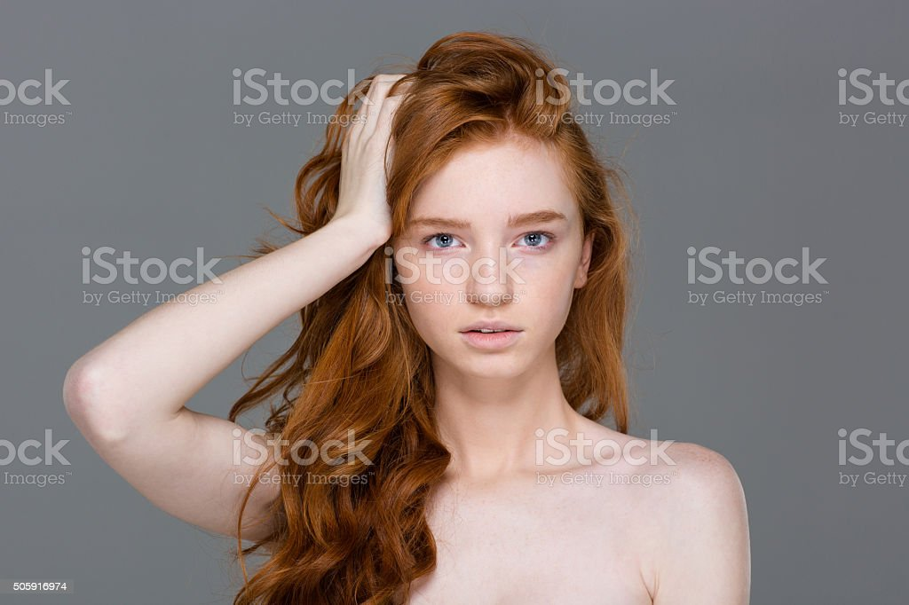 Beauty portrait of tender woman with beautiful long red hair stock photo