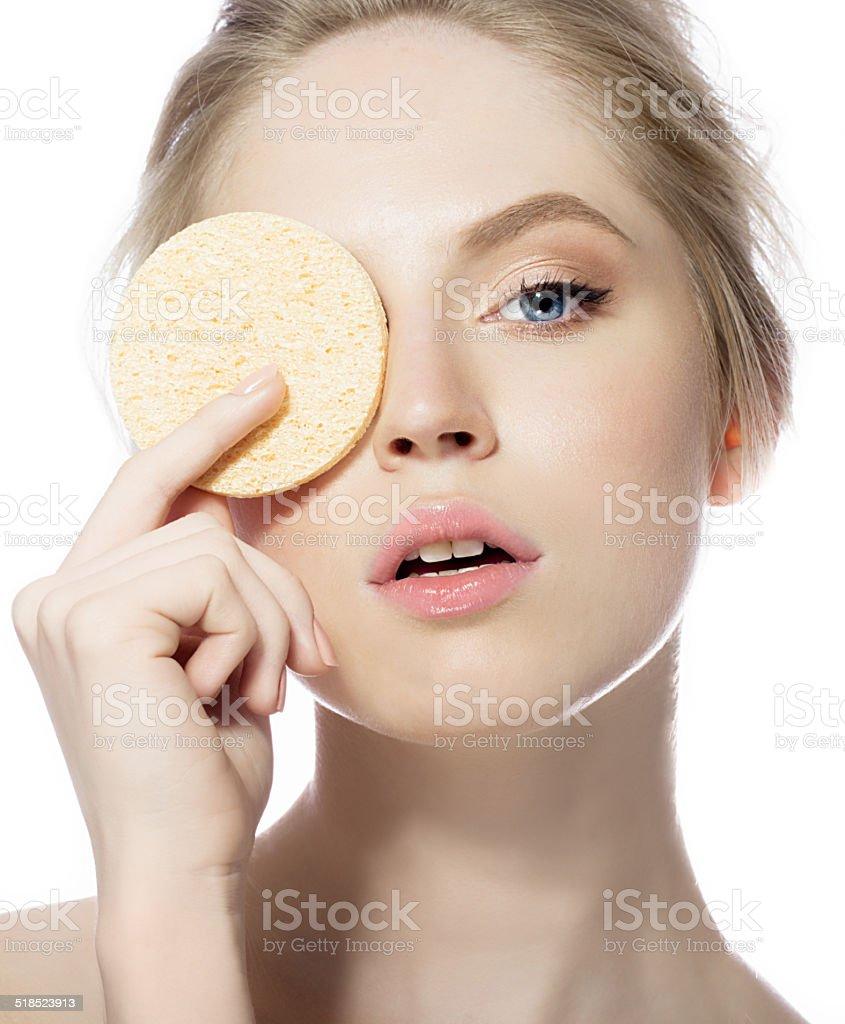 Beauty portrait of woman with make up sponge stock photo