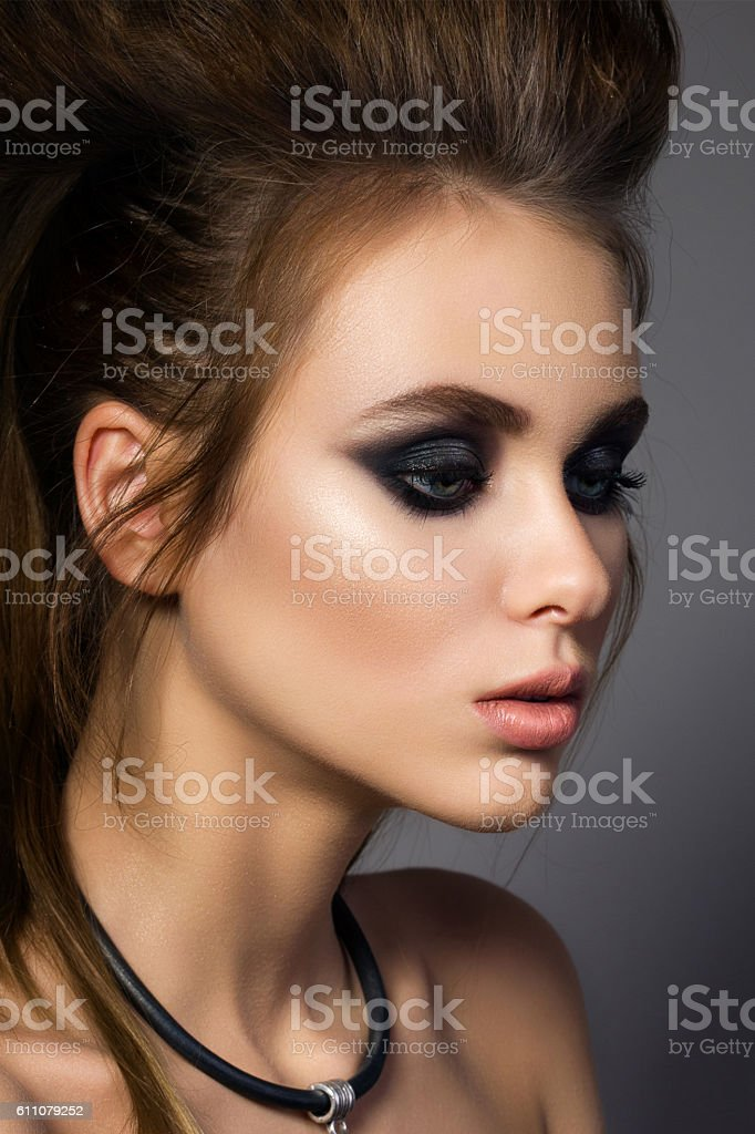 Beauty portrait of young glamorous woman with fashion hairdo stock photo