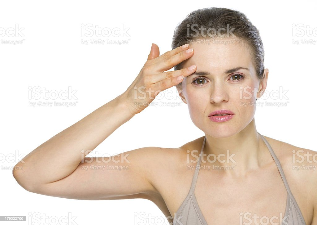 Beauty portrait of young woman checking facial skin royalty-free stock photo