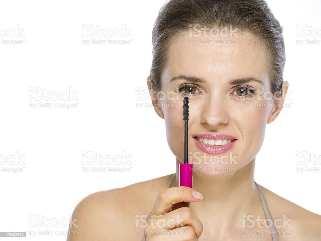 Beauty portrait of young woman holding mascara brush royalty-free stock photo