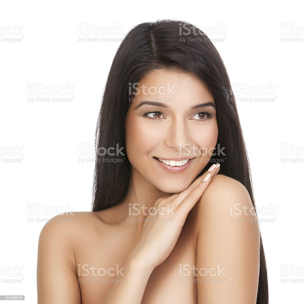 beauty portrait of young woman with hand on her shoulder royalty-free stock photo