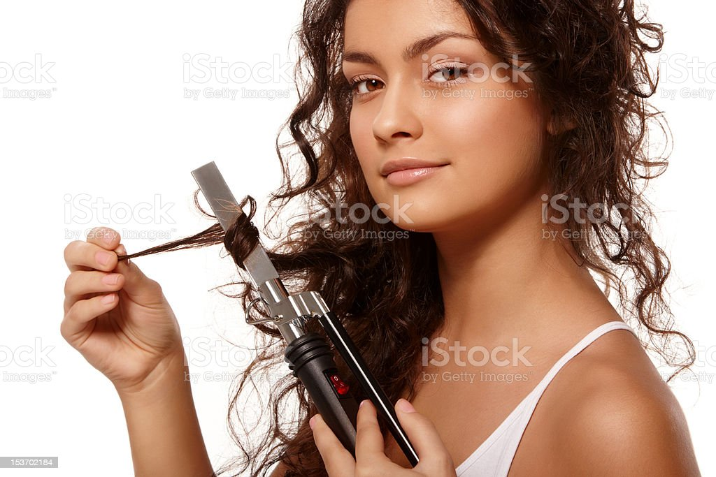 Beauty portrait with curling iron stock photo
