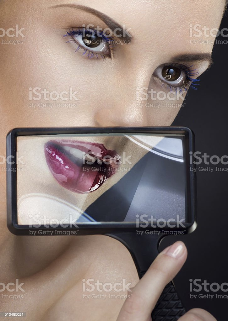 Beauty portrait with loupe royalty-free stock photo