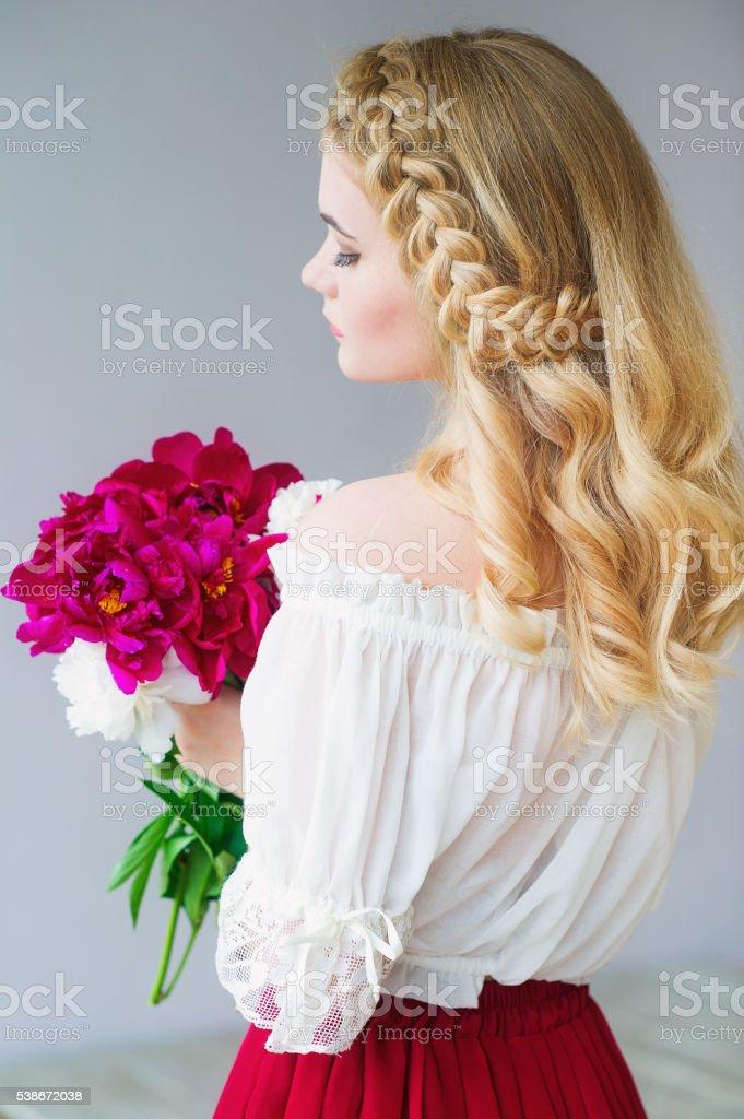 Beauty portrait with peonies stock photo