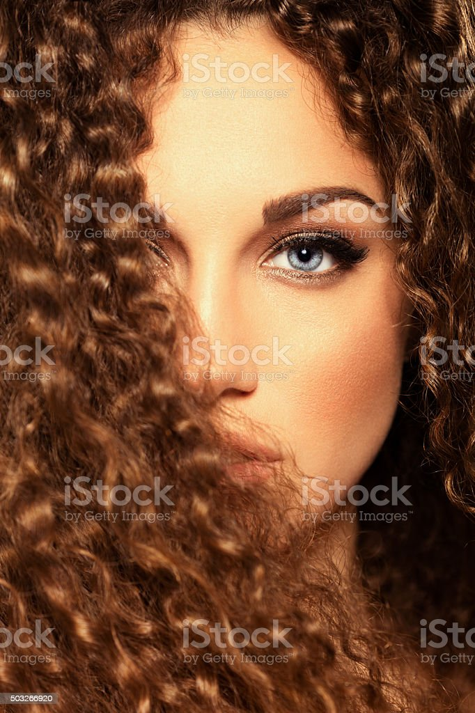 Beauty portrat of girl with curly hair stock photo