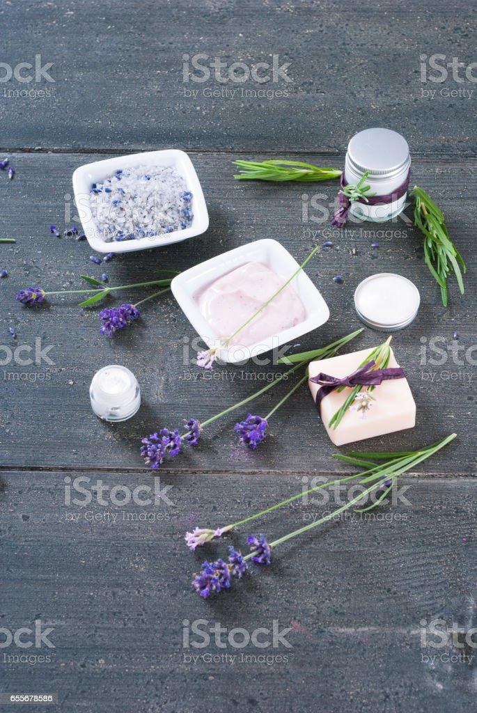 Beauty product samples with lavender on black stock photo