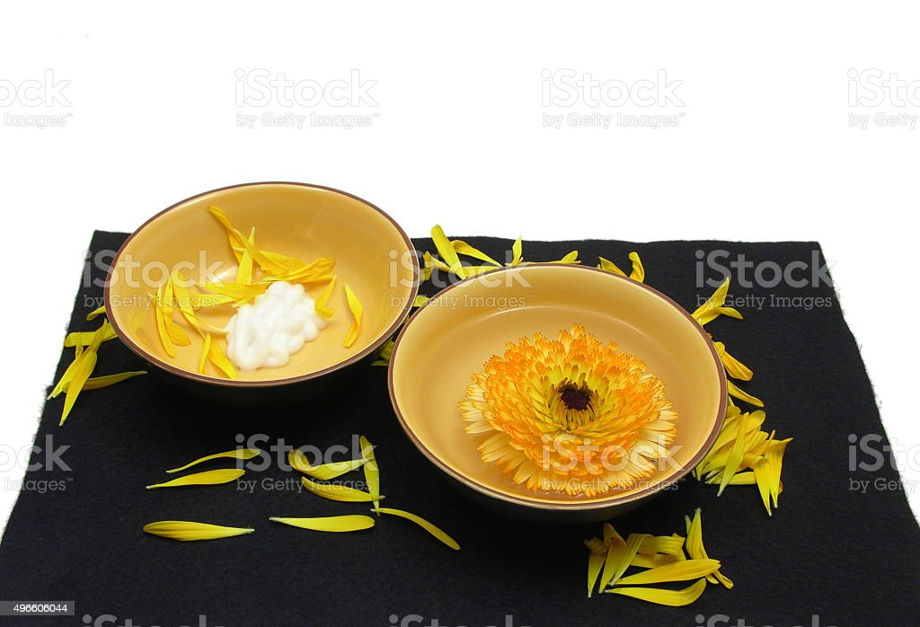 Beauty products of marigold on black and white background stock photo