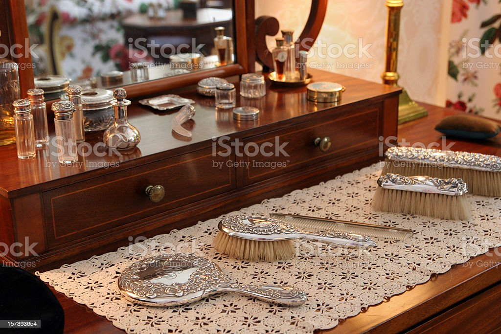 beauty products on antique dressing table stock photo