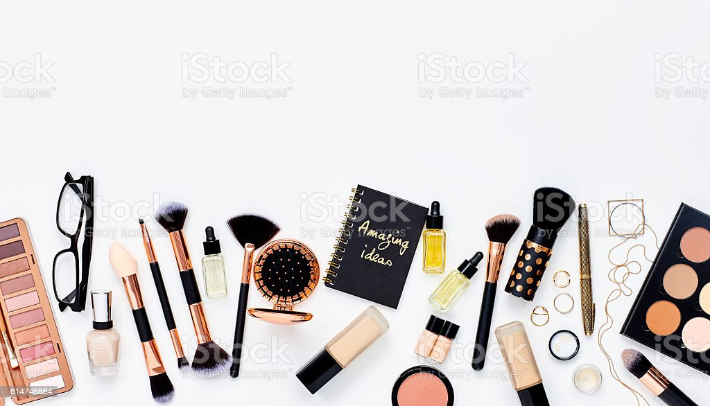 Beauty products with jewelry and note pad on white background stock photo