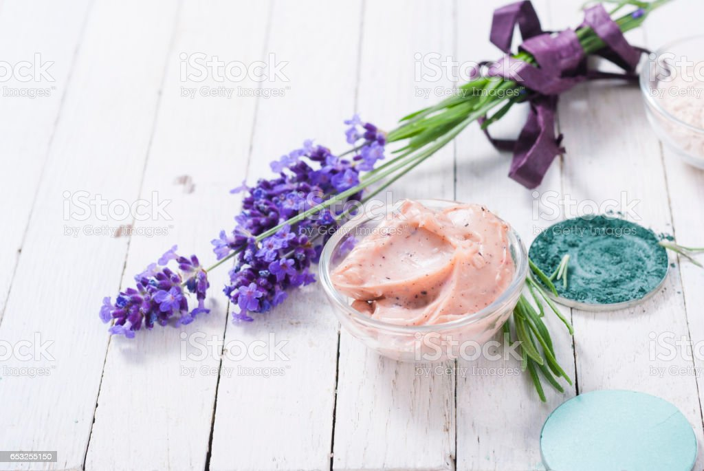 Beauty products with lavender on white wooden stock photo