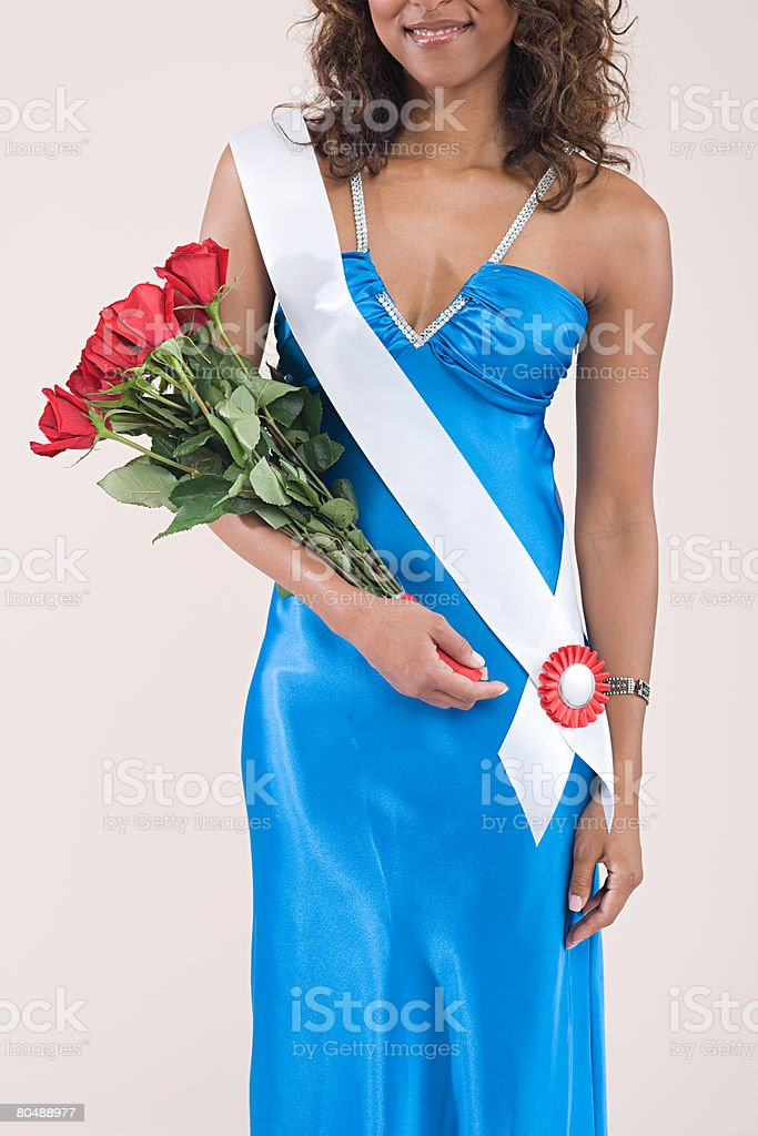 Beauty queen holding a bouquet stock photo