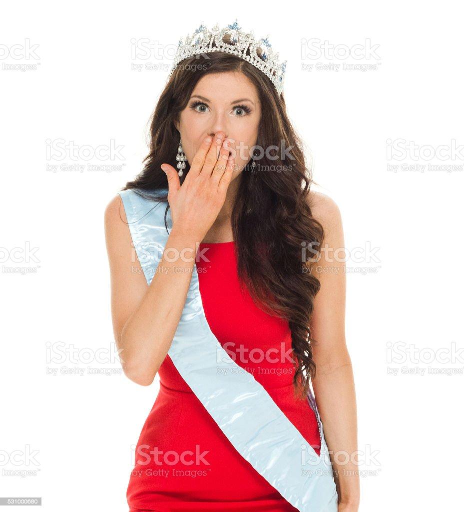 Beauty queen looking shocked stock photo