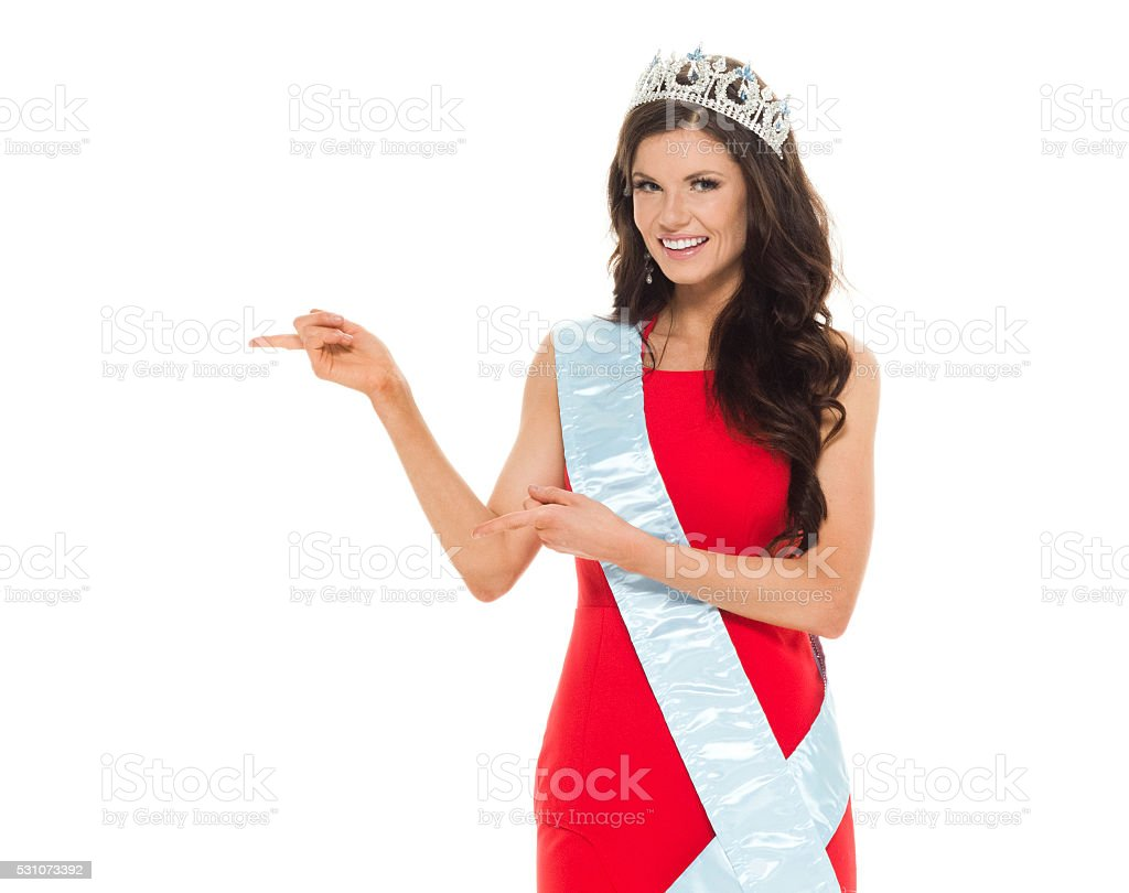 Beauty queen showing something stock photo