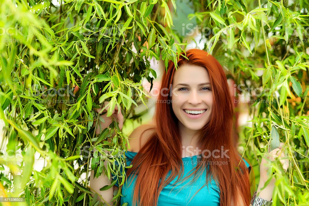 beauty red hair woman in summer garden stock photo