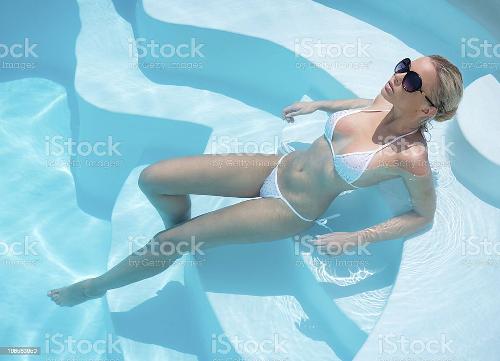 Beauty relaxing in the Pool stock photo