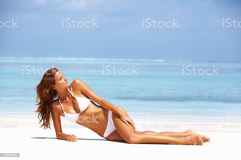 Beauty resting on beach stock photo