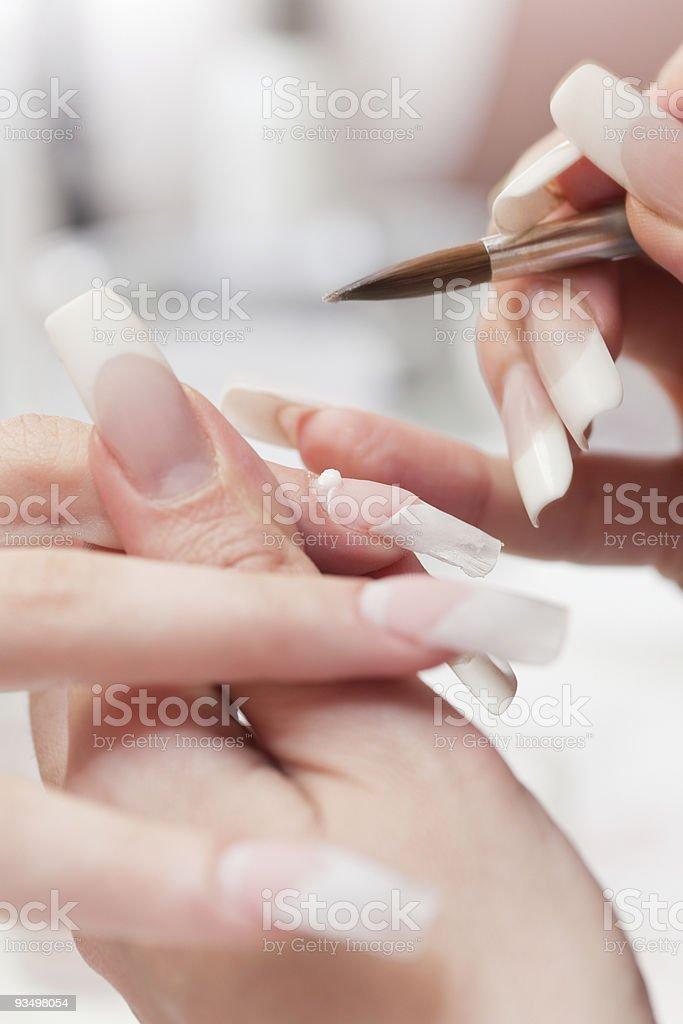 Beauty salon: Manicure, painting on nail royalty-free stock photo