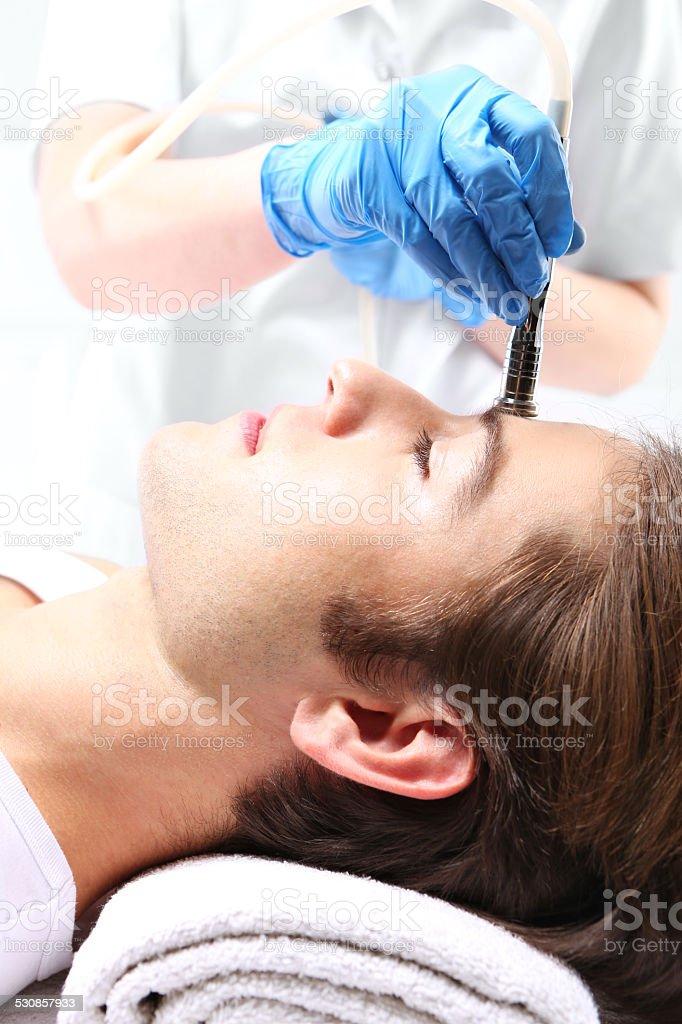 Beauty salon, microdermabrasion stock photo
