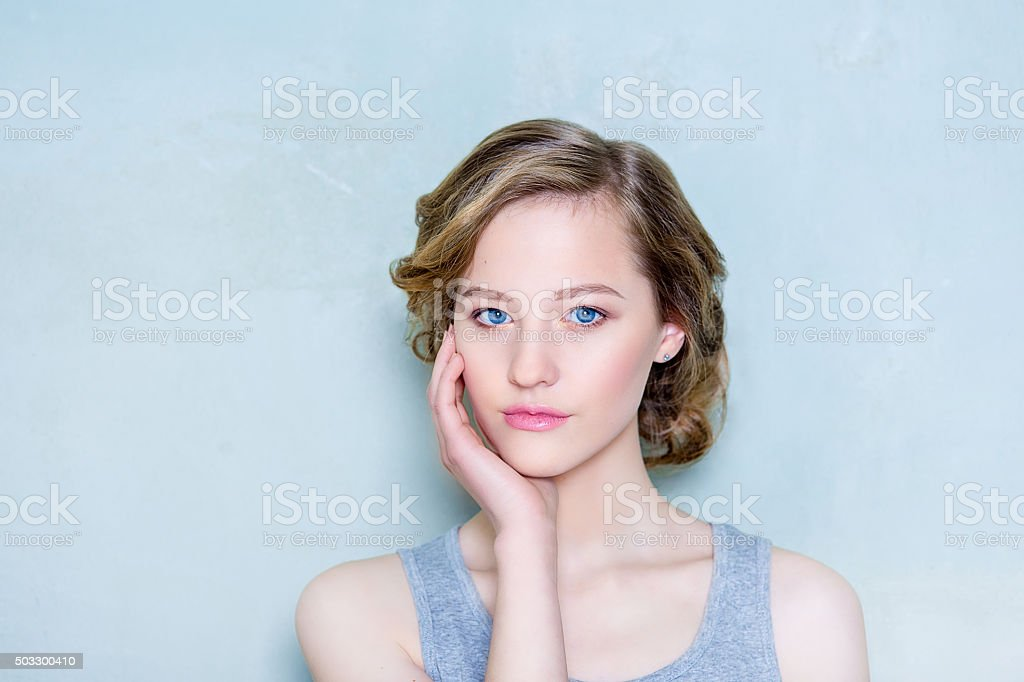 Beauty shooting of the girl on a blue background stock photo