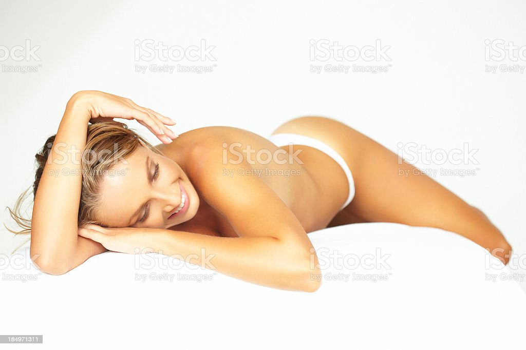 Beauty shot of beautiful, blonde woman relaxing on massage table royalty-free stock photo