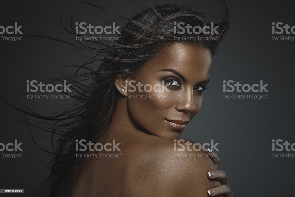 Beauty Shot of Beautiful, Brunette Woman with Long Fluttering Hair stock photo