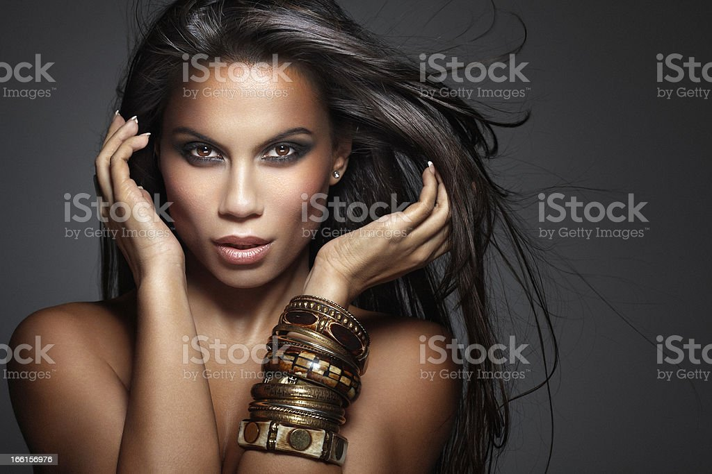 Beauty Shot of Beautiful, Mixed-race Woman with Long Fluttering Hair stock photo