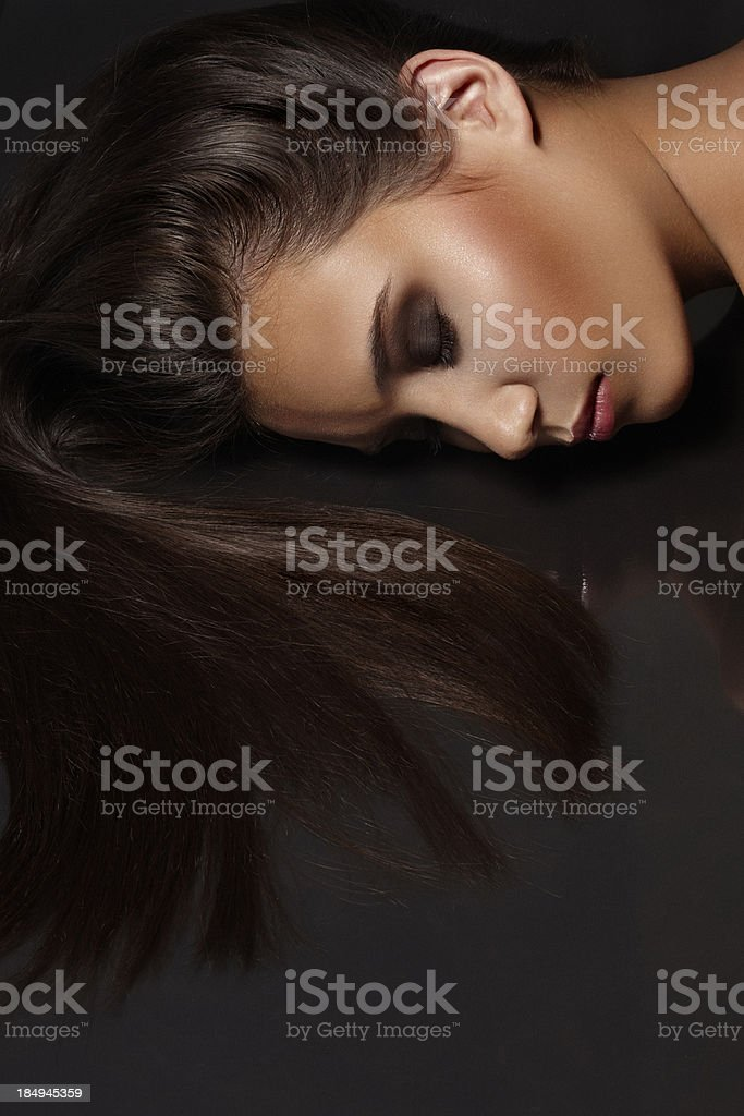 Beauty shot of beautiful woman's face, with long straight hair royalty-free stock photo