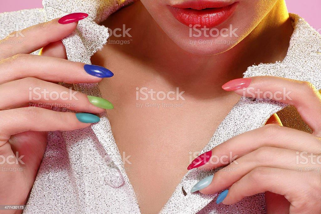 Beauty shot of model wearing colorful nail polish stock photo