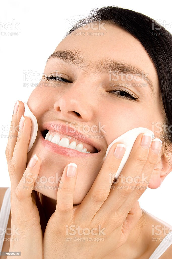 Beauty smiling girl with cotton pads stock photo
