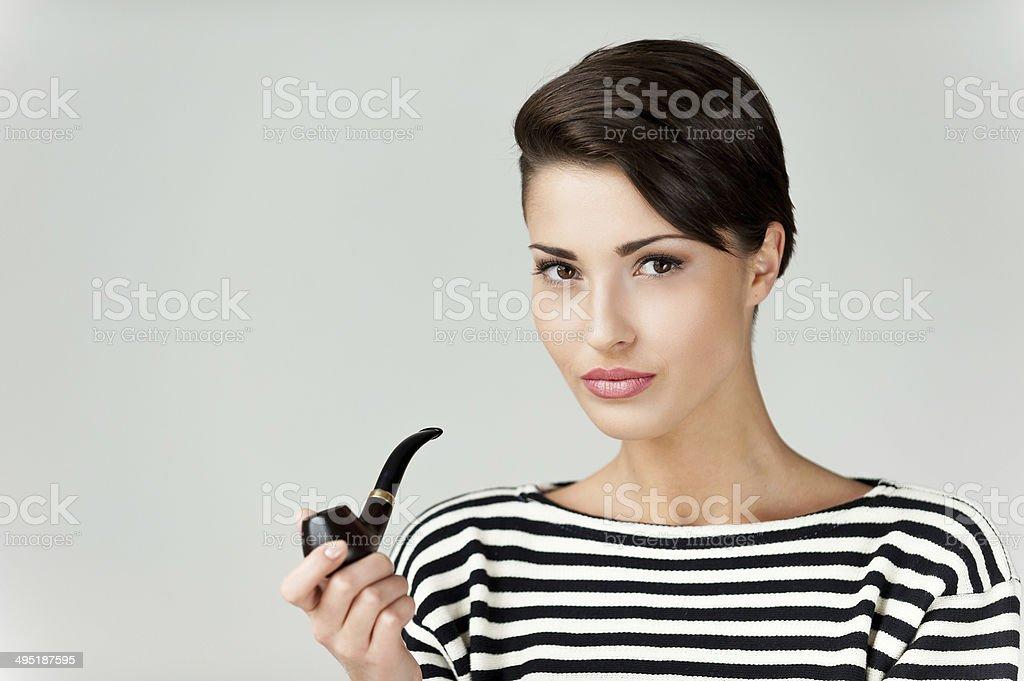 Beauty smoking pipe. stock photo