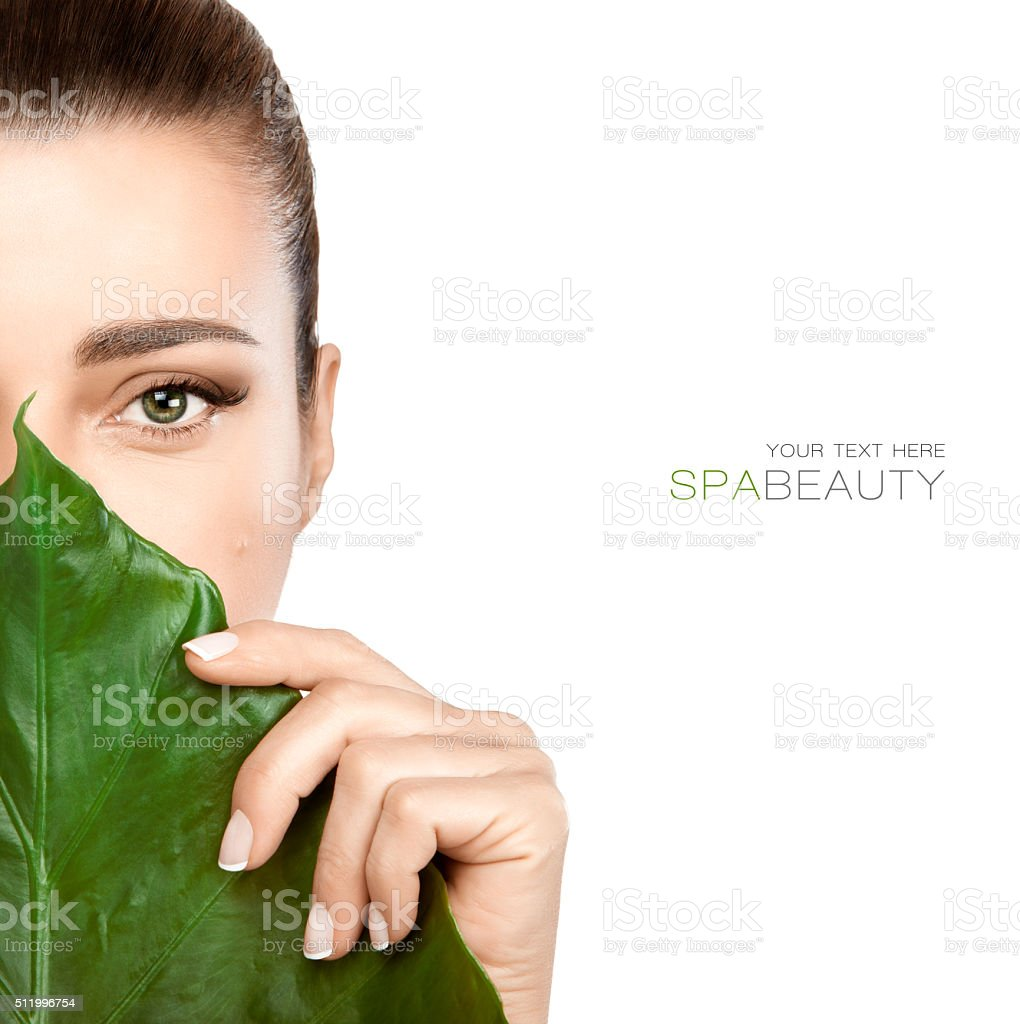 Beauty Spa Woman with a Fresh Leaf over Face stock photo