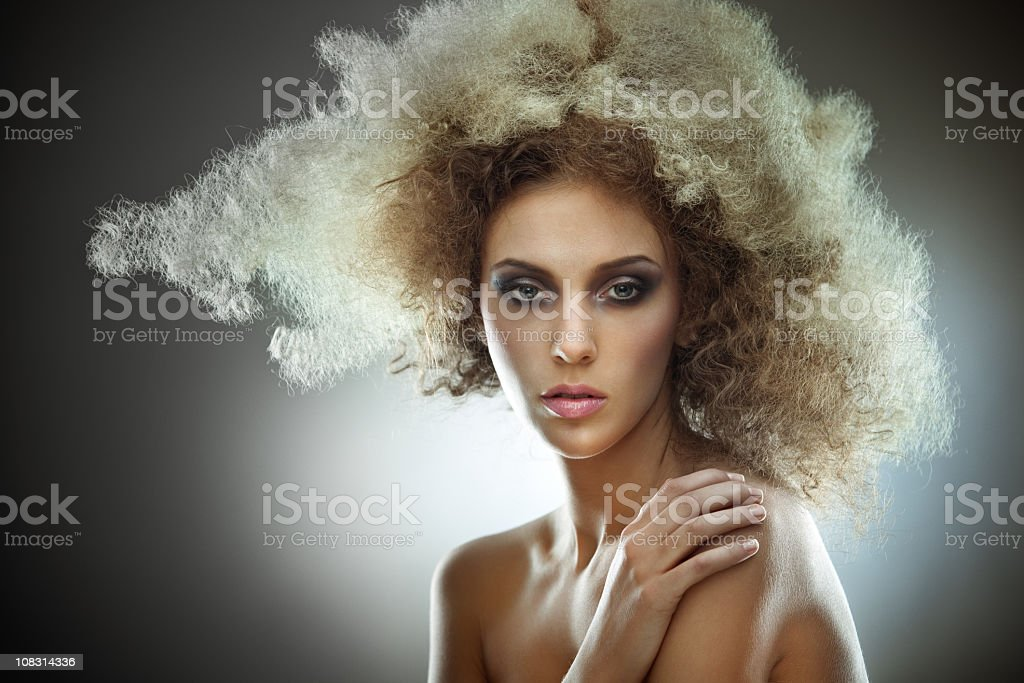 Beauty studio shot of sensual young woman on dark background royalty-free stock photo