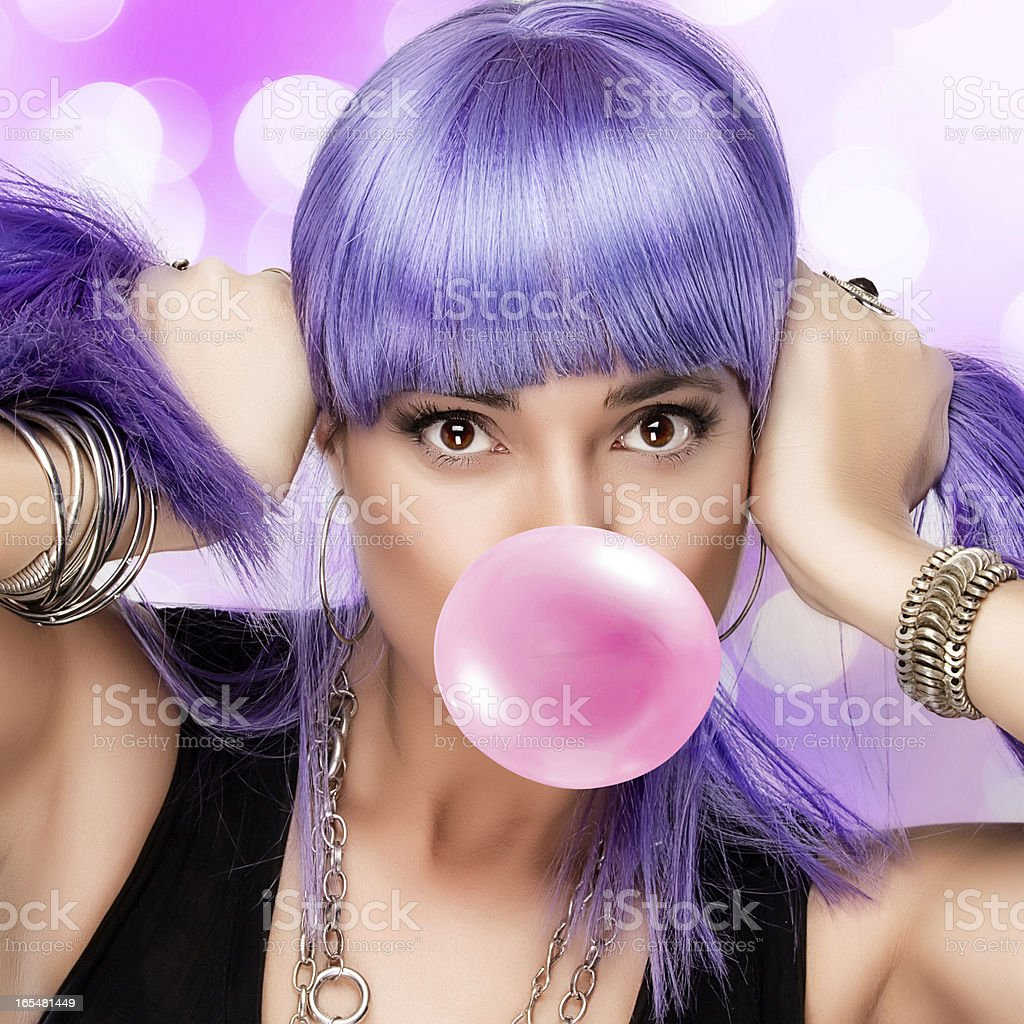 Beauty Stylish Party Girl. Purple Wig and Bubble Gum royalty-free stock photo