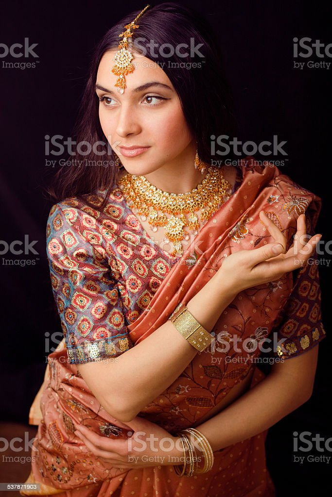 beauty sweet real indian girl in sari smiling stock photo