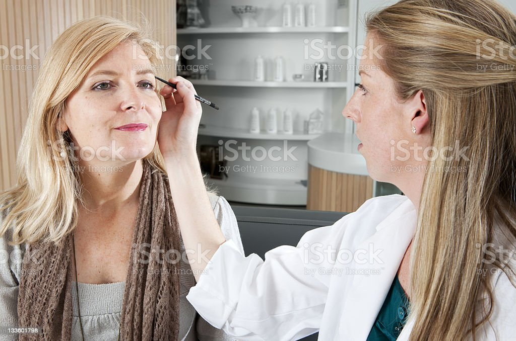 Beauty technician working on a clients eyebrows stock photo