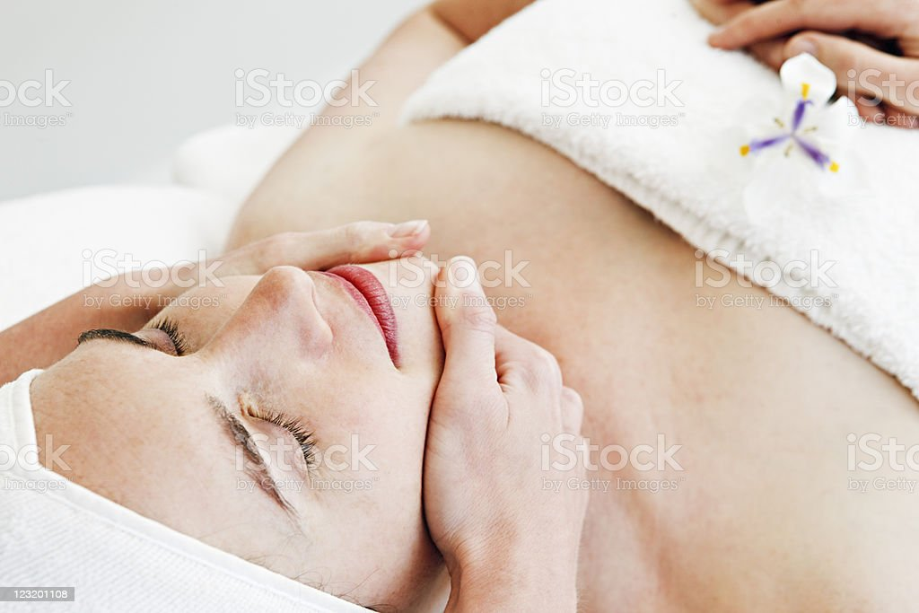 Beauty therapist gives face massage royalty-free stock photo